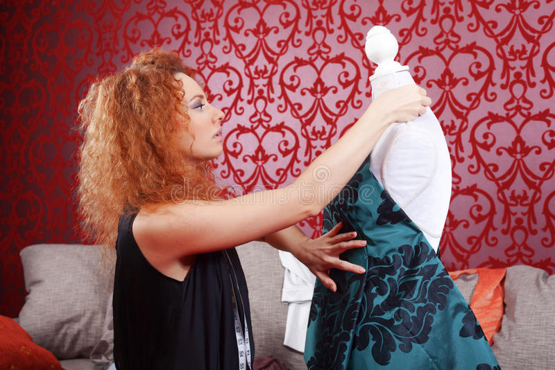 Fashion designer at work. Fashion designer is working on the new collection royalty free stock photos