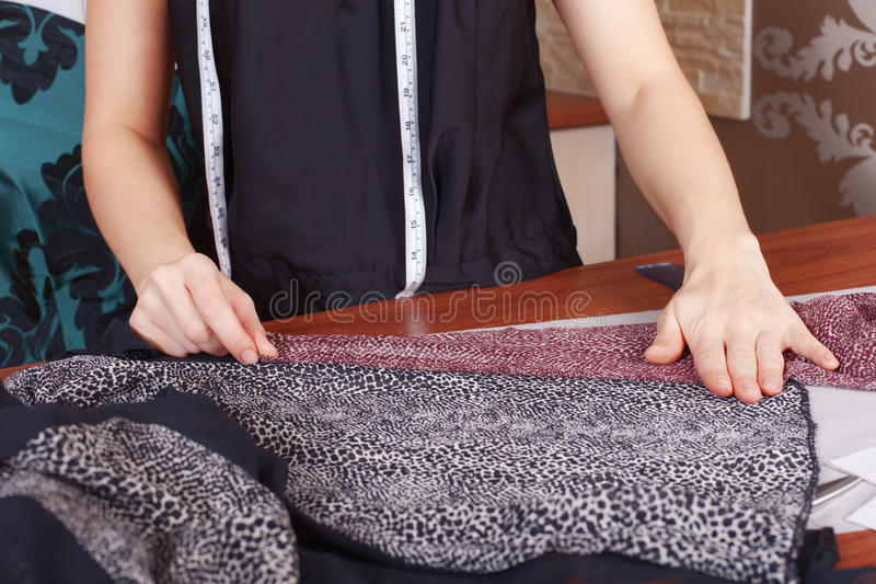 Fashion designer at work. Fashion designer is working on the new collection stock photo