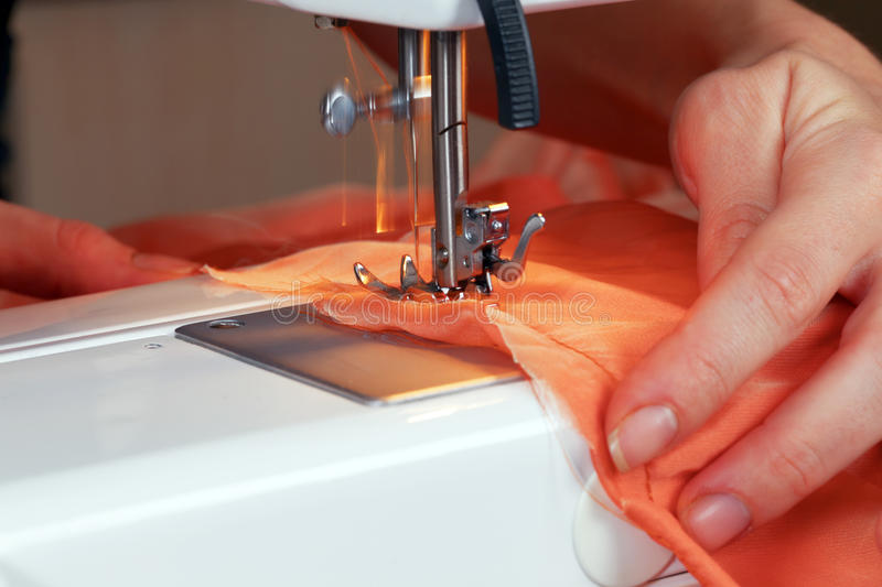 Fashion designer at work. Fashion designer is working on the new collection royalty free stock photo