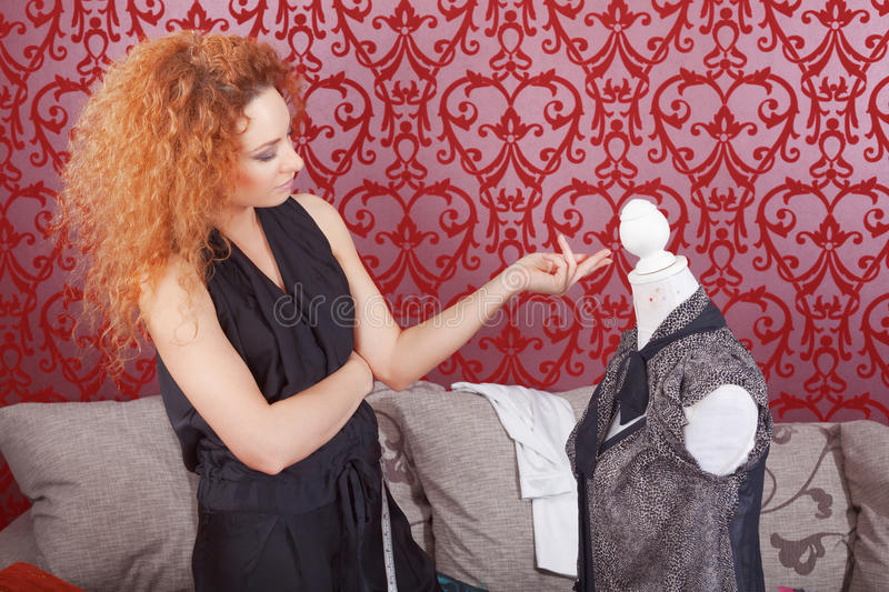 Fashion designer at work. Fashion designer is working on the new collection royalty free stock images