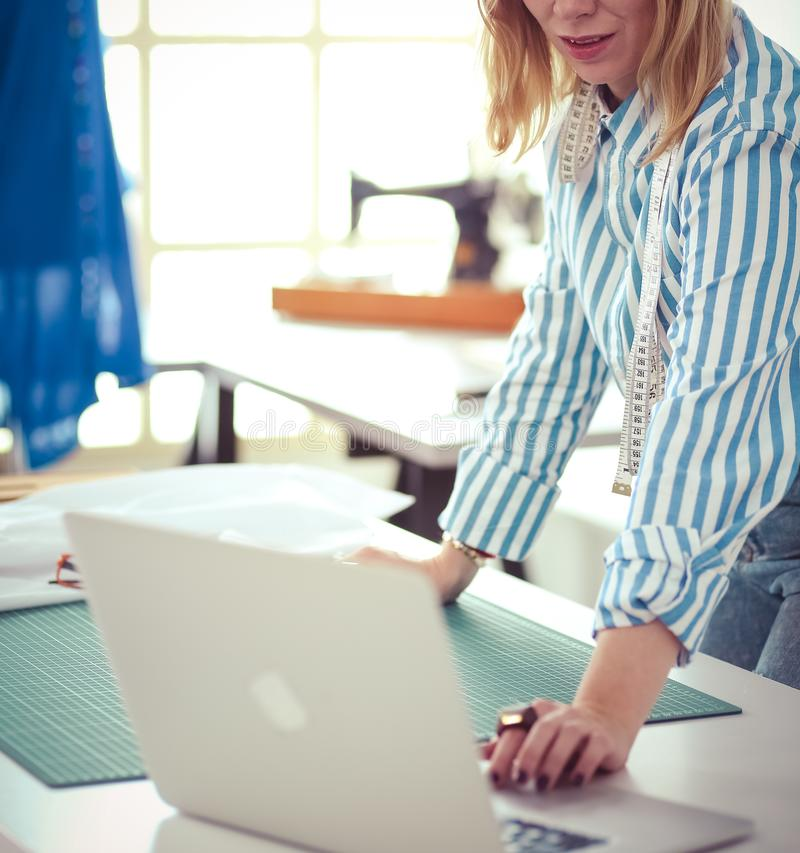 Fashion designer working on her designs in the studio stock photography