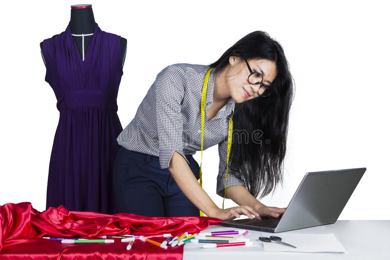 Fashion designer working with laptop royalty free stock photography