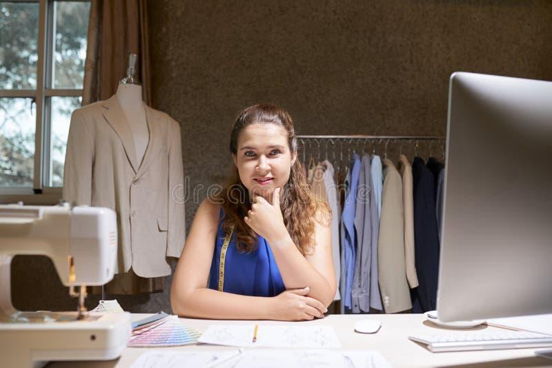 Fashion designer working in workshop royalty free stock photo
