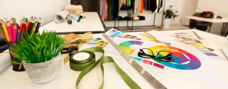 Fashion designer workplace background, panorama, shallow depth stock photos