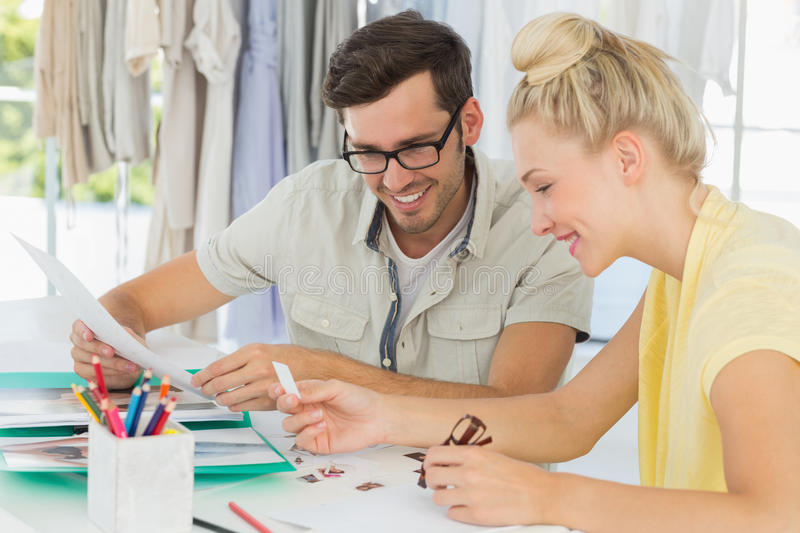 Fashion designers discussing designs royalty free stock image