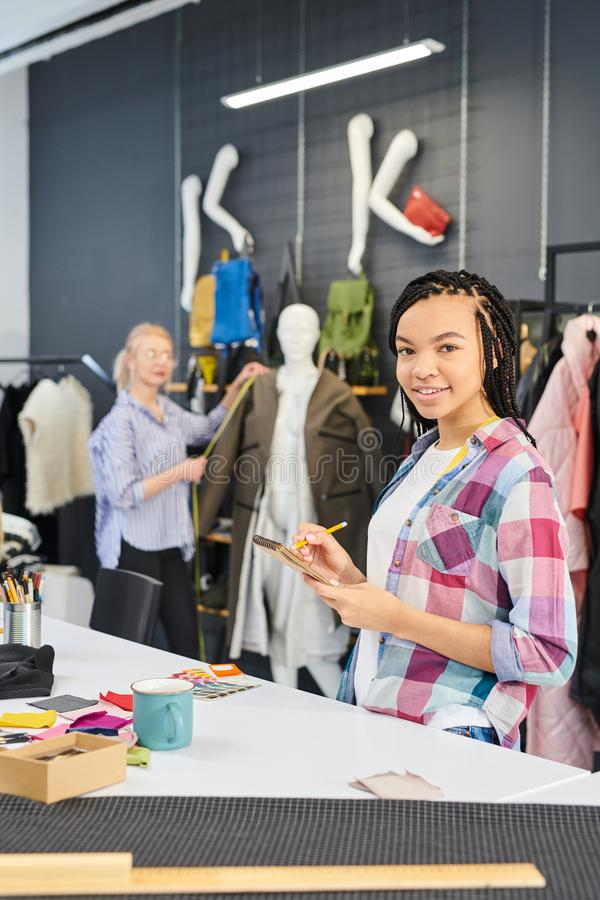 Fashion designers sewing clothes stock photography