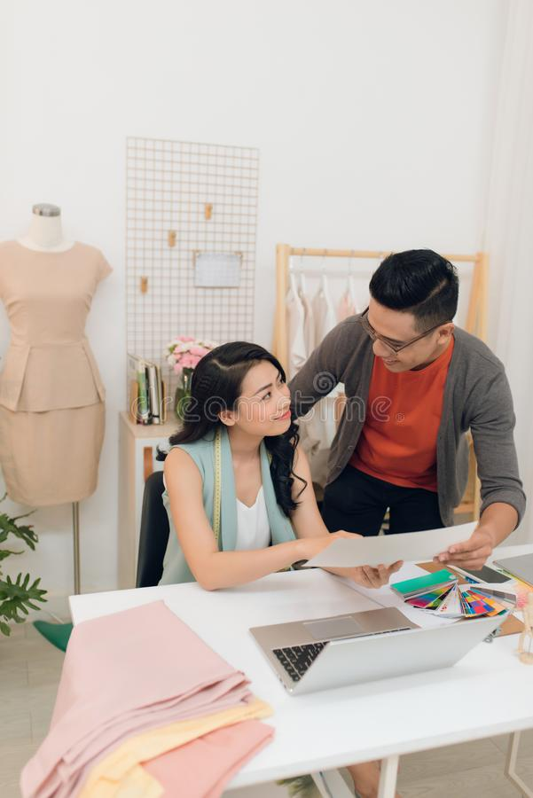 Fashion designers working on creation in workshop royalty free stock image