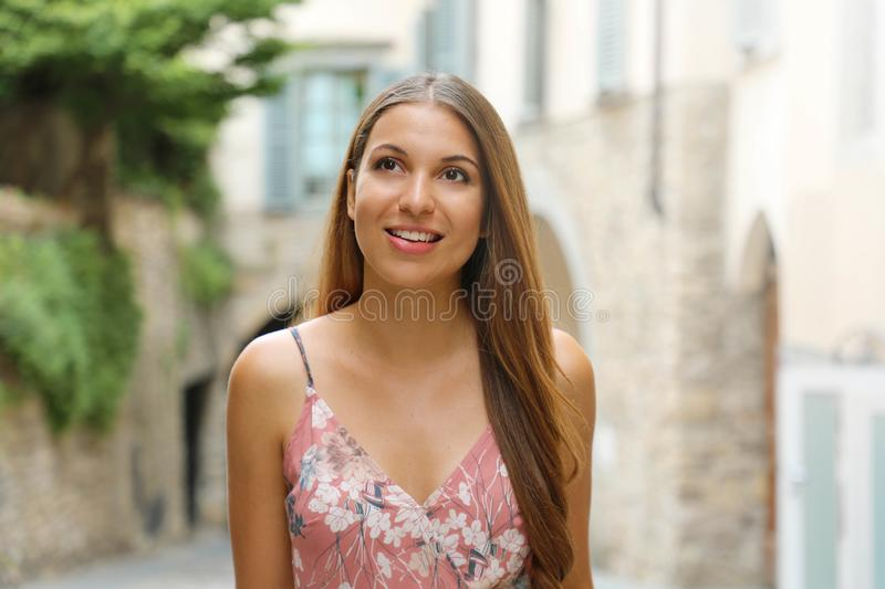 Fashion dressed woman walking in the streets of a small Italian medieval town stock photo