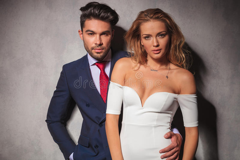 Fashion elegant couple standing embraced in studio stock images
