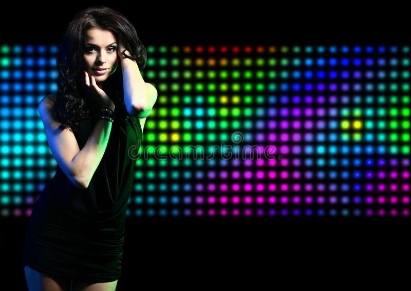 Fashion expressive girl dancing at disco royalty free stock photos