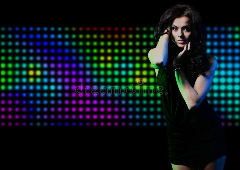 Fashion expressive girl dancing at disco light. stock images