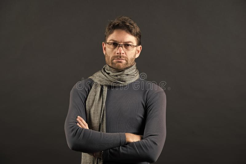 Fashion, eyewear, accessory. Businessman in glasses on bearded face. Eyesight correction, eye care, health. Man in scarf and sweater with folded hands. Vision royalty free stock image