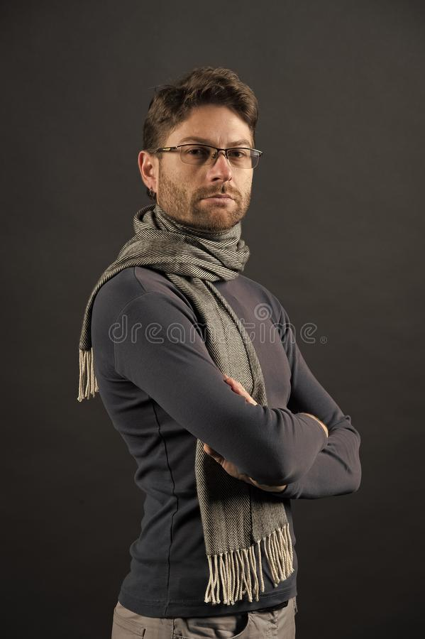 Fashion, eyewear, accessory. Businessman in glasses on bearded face. Man in scarf and sweater with folded hands. Vision, business, future concept. Eyesight royalty free stock images