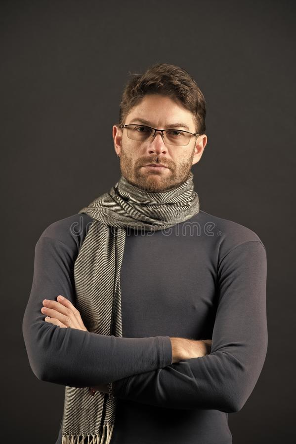 Fashion, eyewear, accessory. Vision, business, future concept. Man in scarf and sweater with folded hands. Eyesight correction, eye care, health. Businessman stock image