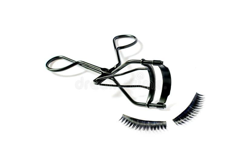 Fashion fake false eyelash and eyelash curler isolated. On white background royalty free stock photos