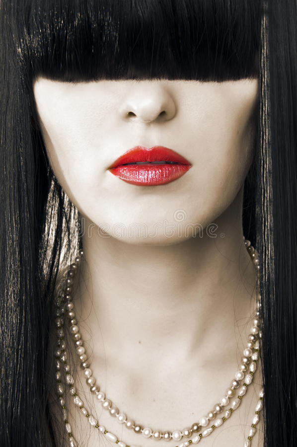 Fashion female face with red lips stock photography