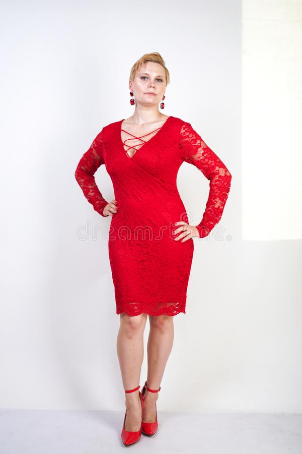 Free Fashion Female In Red Lace Dress Standing Alone. Plus Size Blonde Woman With Short Hair And Chubby Body Posing In Evening Middle L Stock Photography - 152103842