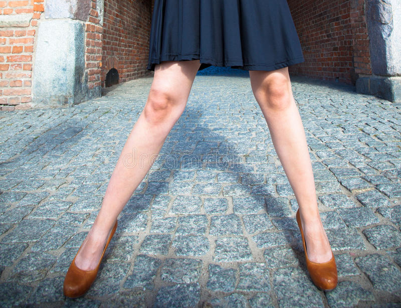 Fashion. Female legs in stylish shoes outdoor stock images