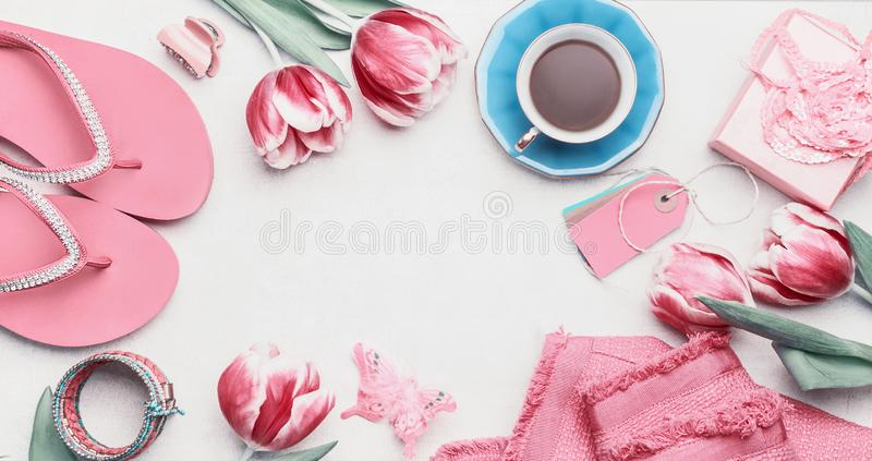 Fashion feminine blogger concept. Set of pink woman accessories on white background. Still life of objects: tulips, cosmetics, royalty free stock images