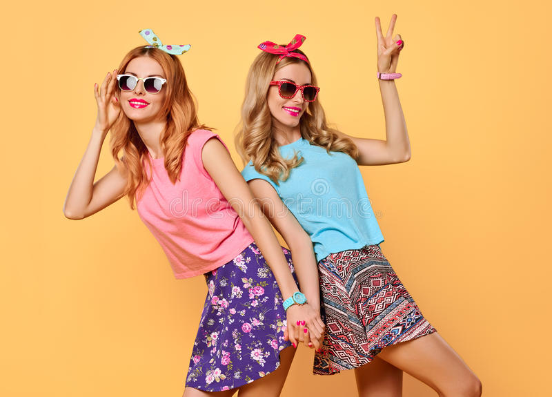 Fashion Funny girl Crazy Having Fun, Dance.Friends. Fashion Hipster women Having Fun Crazy Cheeky Dance. Hipster Sisters Best Friends Twins in Stylish Summer royalty free stock photography