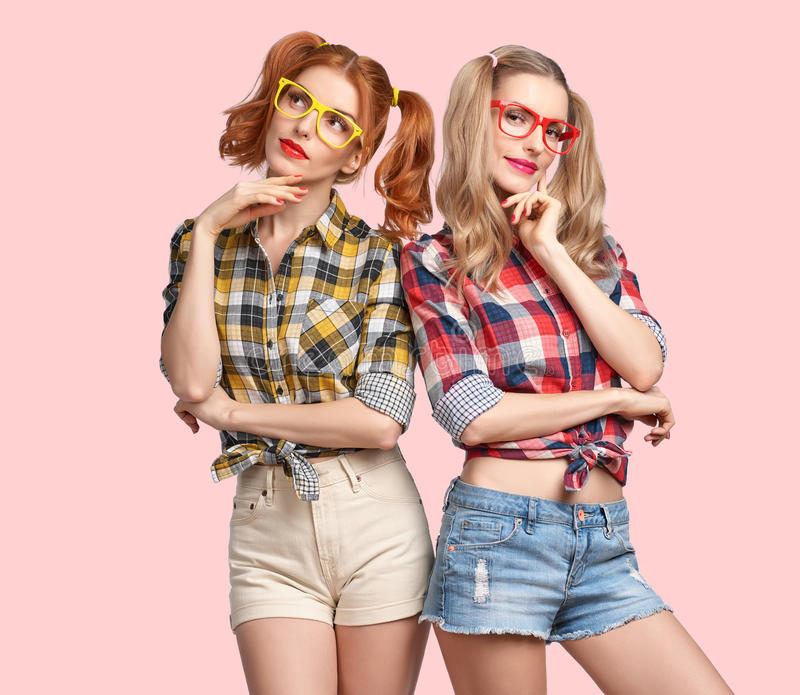 Fashion Funny girl Thinking Idea. Smiling Nerd. Fashion Hipster women Thinking Idea. Having Fun. Hipster Sisters Best Friends Smile. Twins in Trendy Plaid Shirt stock photos