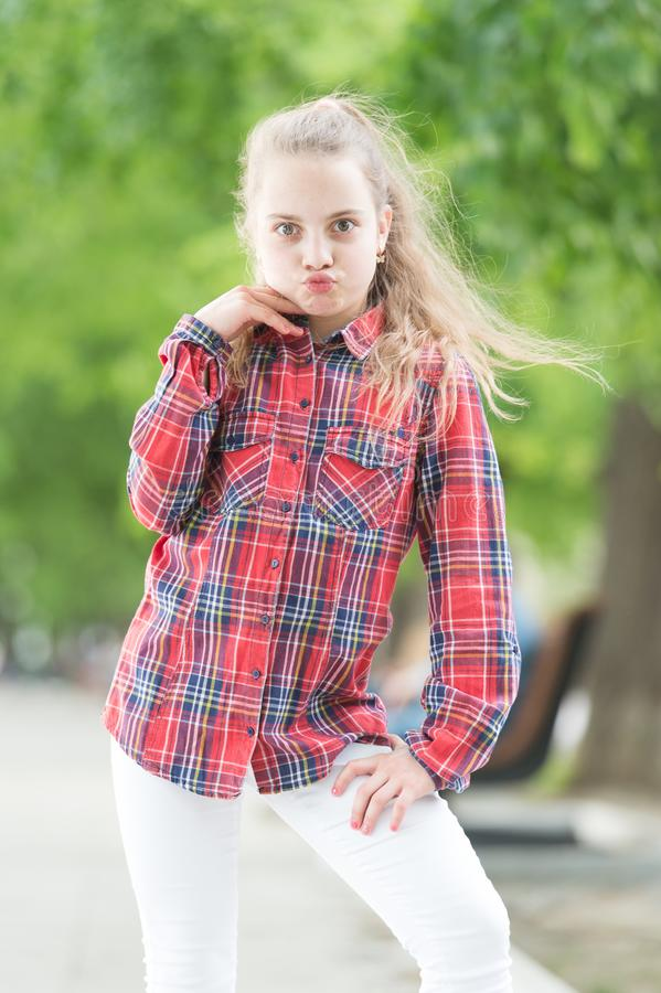 Fashion generation. Adorable girl of fashion wearing plaid shirt on summer day. Fashionable little child in casual. Fashion on city street. Fashion look of stock photo