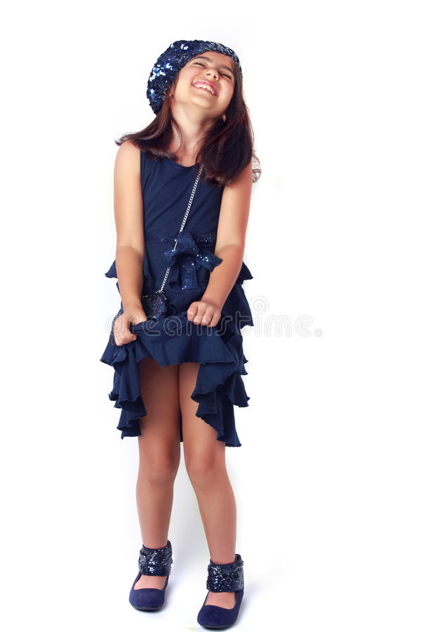 Fashion girl. Little girl all dressed up for a party stock image