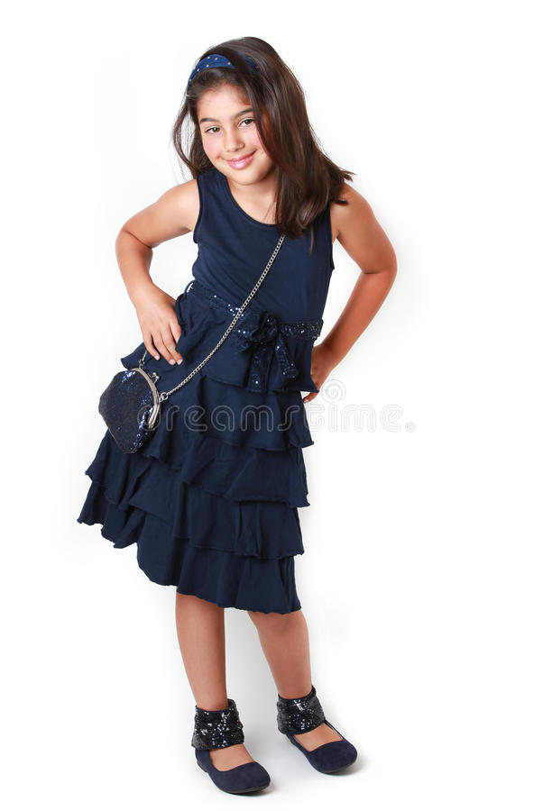 Fashion girl. Little girl all dressed up for a party royalty free stock photography