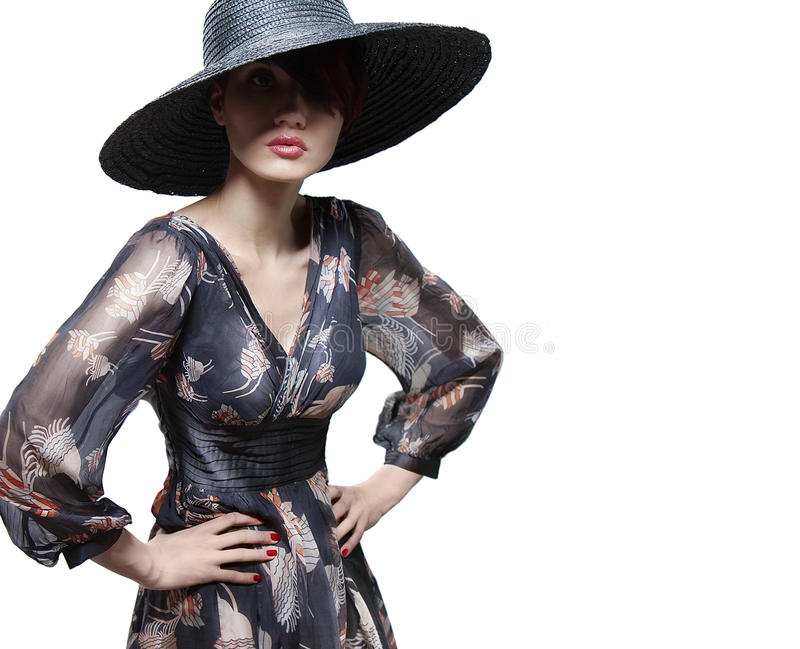 Fashion girl in a big hat in the studio royalty free stock images