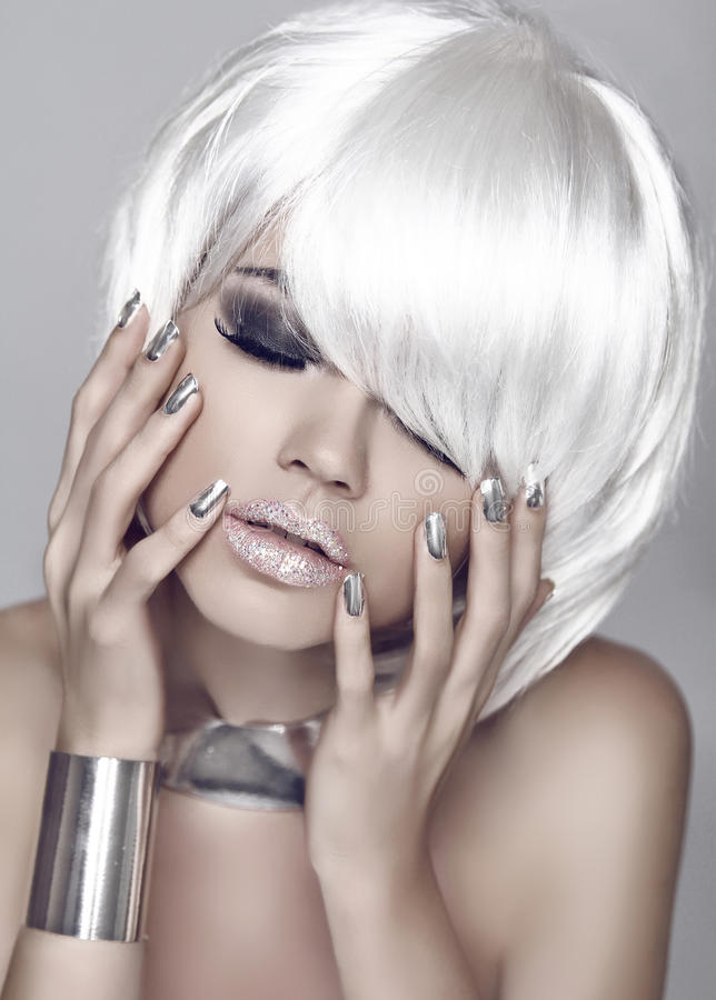 Fashion girl. Blond bob hairstyle. Eye makeup closeup. Beautiful stock images
