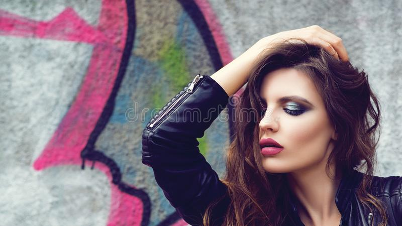Fashion girl with bright makeup. pretty and successful. Street style fashion woman. Girl in leather jacket. Sensual lips royalty free stock image