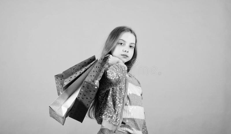 Fashion girl customer. Happy child in shop with bags. Shopping day happiness. Birthday girl shopping. Fashion boutique. Fashion trend. Fashion shop. Little stock images