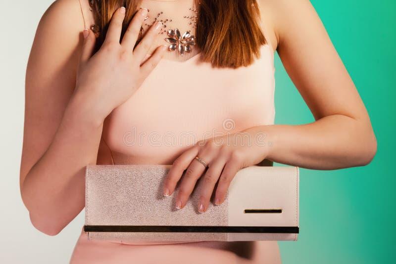 Fashion girl with elegant handbag bag. Female elegance. girl young woman holding in hand elegant handbag bag luxury accessory on green stock image