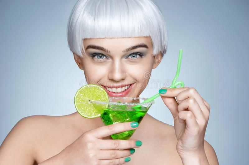 Download Fashion Girl With Glass Of Cocktail On Blue Background Stock Photo - Image of antioxidant, care: 117257326