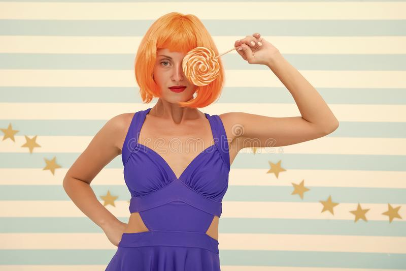 Fashion girl with orange hair having fun. Crazy girl in playful mood. happy pinup model with lollipop in hand. Cool girl. With lollipop. Sexy woman. party time stock images