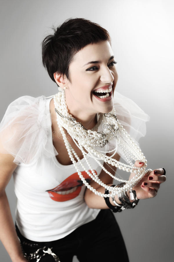 Fashion girl with pearl necklaces. Beautiful girl with short black hair, and pearl necklaces stock photos
