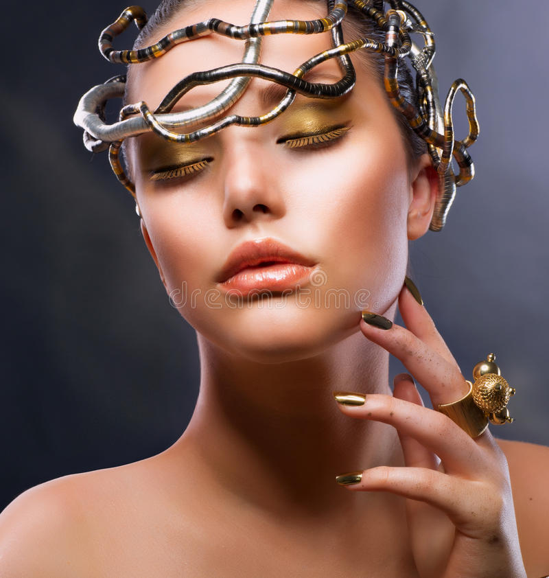Fashion Girl Portrait. Gold Makeup stock images