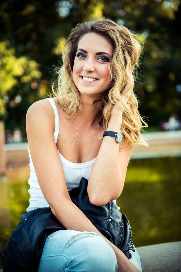 Fashion girl posing with leather jacket stock image