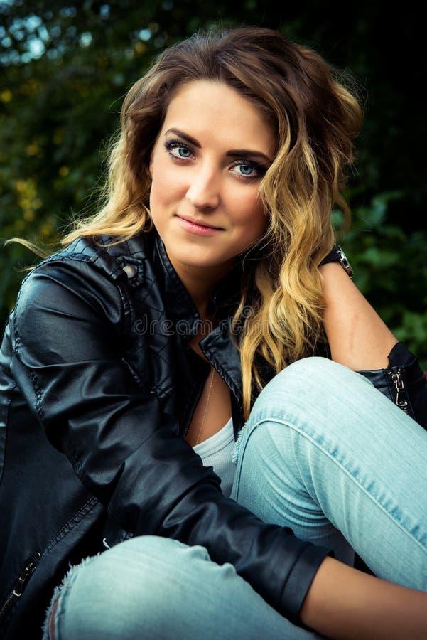 Fashion girl posing with leather jacket royalty free stock image