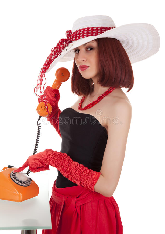 Fashion girl in retro style with vintage phone royalty free stock photography