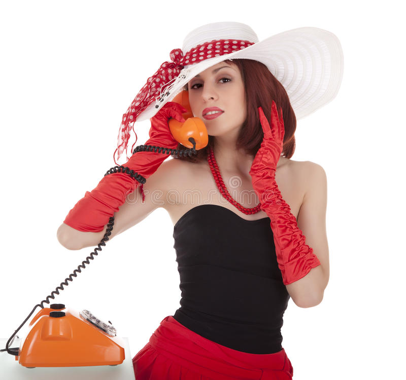 Fashion girl in retro style with vintage phone royalty free stock image