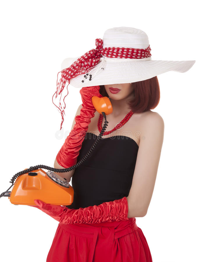 Fashion girl in retro style with vintage phone stock photo