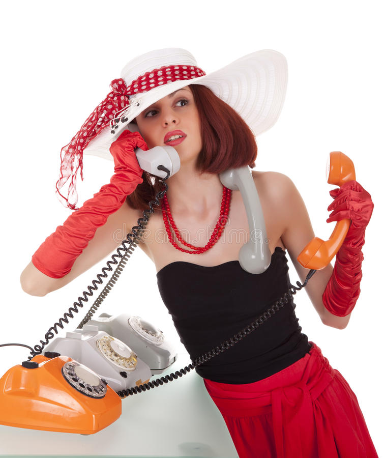 Fashion girl in retro style with vintage phones royalty free stock photos