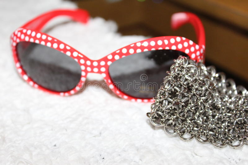 Fashion girl Sunglasses with bracelet stock photo