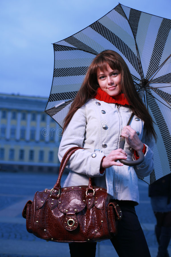 Fashion girl with umbrella. At Palace Square, St. Petersburg, Russia royalty free stock photos