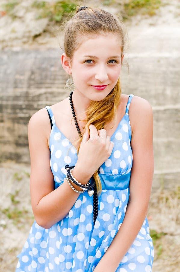 Fashion girl urbex location blue polka dress stock images
