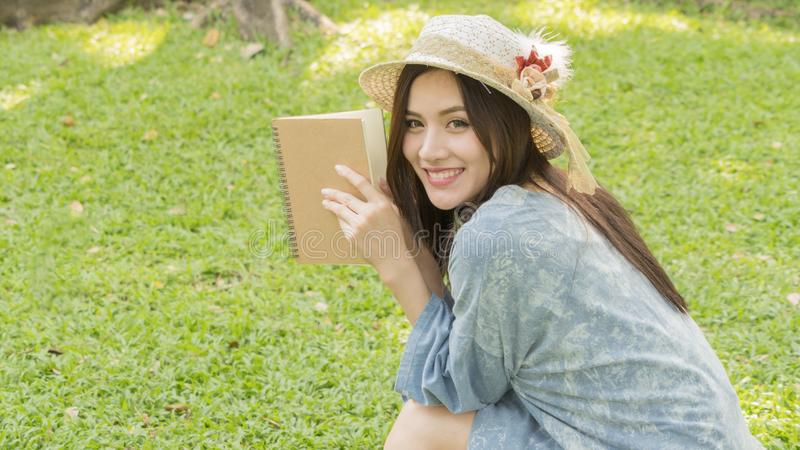 Fashion girl use a book and read in garden park royalty free stock image