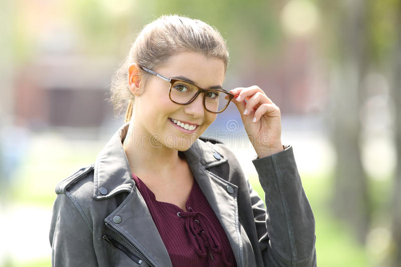 Fashion girl wearing eyeglasses looking at you stock images