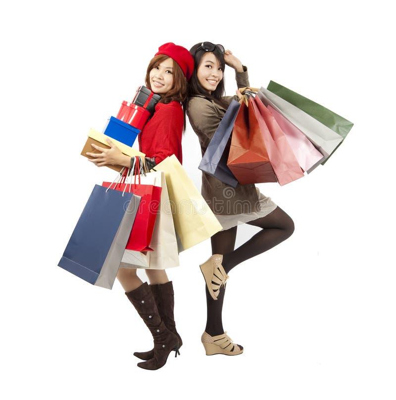 fashion girls holding shopping bag stock photography