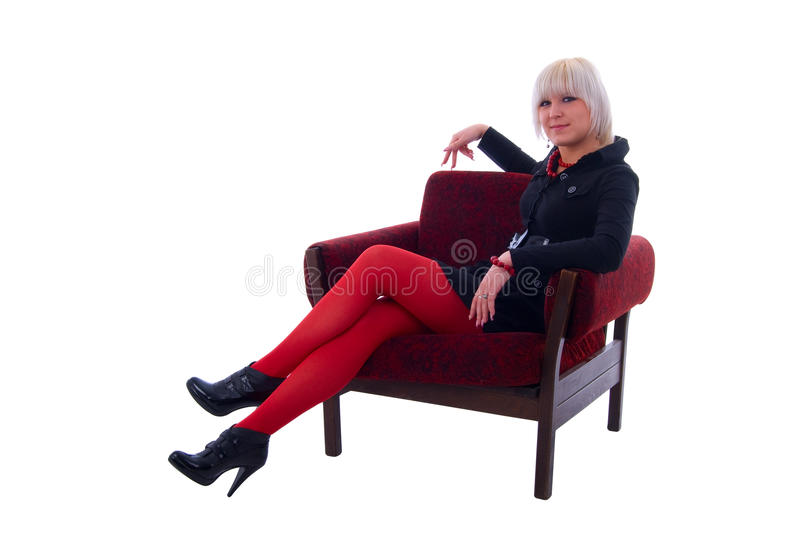 Fashion Glamour Girl Sitting In Soft Chair. Isolated On White Background royalty free stock image